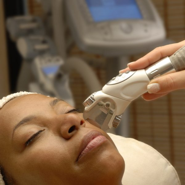 Young,Afro,American,Woman,Getting,Ultrasonic,And,Laser,Face,Treatment